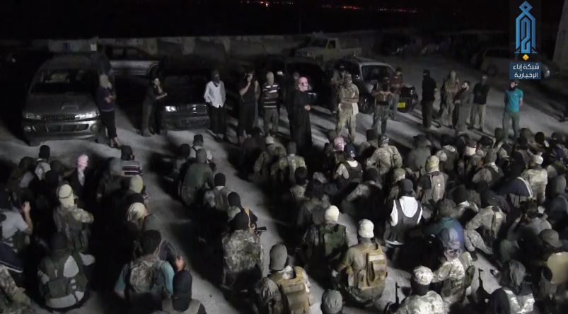 Briefing of operatives of the Headquarters for the Liberation of Al-Sham before leaving to carry out the arrests.