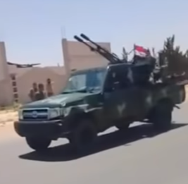 Syrian army vehicle carrying a double-barrel anti-aircraft gun arriving in the Latakia rural area (Muraselon, August 23, 2018)