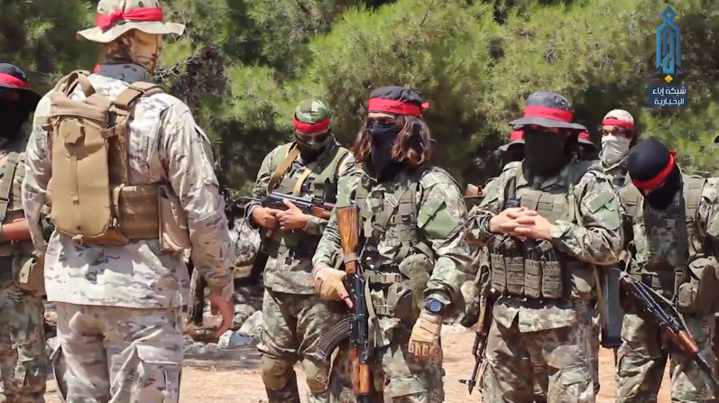 Red Bands fighters of the Headquarters for the Liberation of Al-Sham during training.