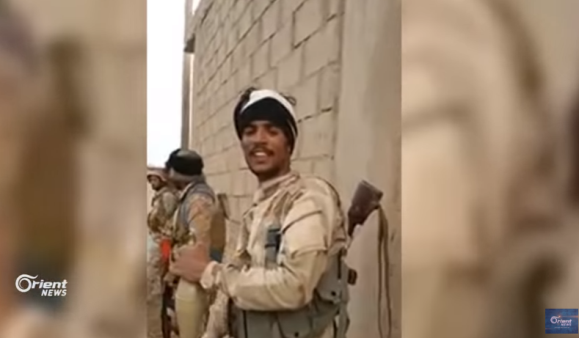 Operatives of the Popular Mobilization (Iraqi Shiite militias) in an area under their control in Albukamal (Orient News YouTube channel, August 19, 2018)