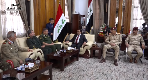Iraqi Defense Minister Erfan Mahmoud al-Hiyali (in the middle, wearing a suit), during his meeting with the deputy chiefs of staff of Russia, Iran, and Syria (Iraqi Defense Ministry Facebook page, September 1, 2018)