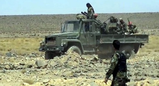 Syrian army soldiers and trucks deep inside the rocky terrain of the Al-Safa area (Syrian TV, September 11, 2018)