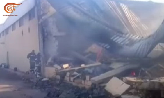 Firefighters near the rubble of the headquarters of the National Oil Corporation (YouTube, September 10, 2018).