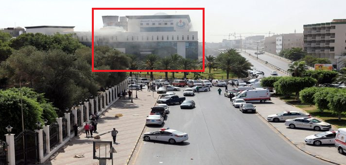 Smoke rising from the headquarters of the National Oil Corporation (in red) following the attack (Erem News, UAE news website, September 11, 2018)