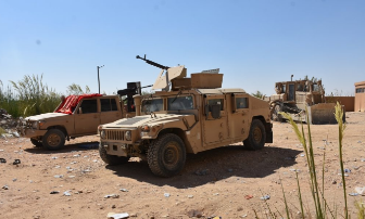A vehicle and a bulldozer of the SDF forces taking part in the fighting north of Albukamal (SDF Media Center, September 28, 2018)