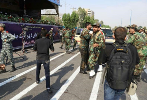 Iranian security personnel, the VIP seating and part of the route of the military parade shortly after the attack (Tasnim News Agency, September 24, 2018)