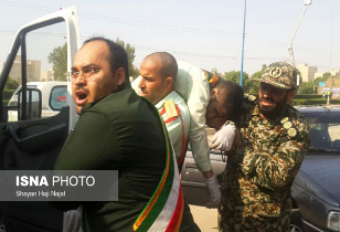 Member of the Revolutionary Guards helping to evacuate one of the wounded (Fars News, September 22, 2018).