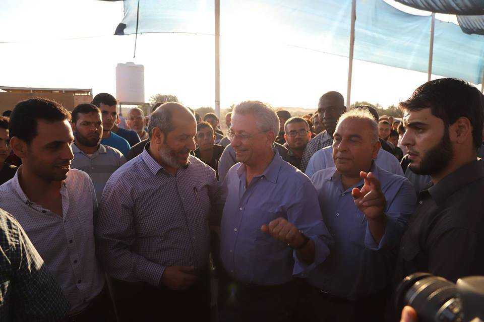 "Khalil al-Haya (second from left), a member of Hamas' political bureau, and Mustafa Barghouti, secretary general of the Palestinian National Initiative, at the ""return camp"" in eastern Gaza City (Palestine Online Twitter account, October 12, 2018). Barghouti came to Gaza from Ramallah, apparently through the Rafah Crossing, in ITIC assessment to show solidarity with the ""return marches."""