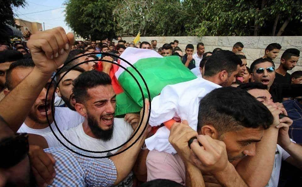 Elias Saleh Yassin at the funeral of Ai'sha al-Bari, killed by stones thrown near the Tapuah Junction (Palinfo Twitter account, October 15, 2018).