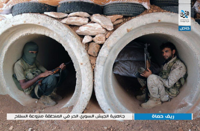 Free Syrian Army fighters in their positions in the demilitarized zone in the rural area of northern Hama (Furat Post Facebook page, October 14, 2018)