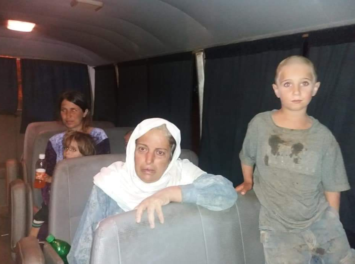 The abducted Druze woman Rasmiya Abu Amar (center). Behind her is Abir Shalgheen and some of her children. The abducted women were transported by a vehicle which took them out of the area controlled by ISIS in Al-Safa (Suwayda 24 Twitter account, October 19, 2018)