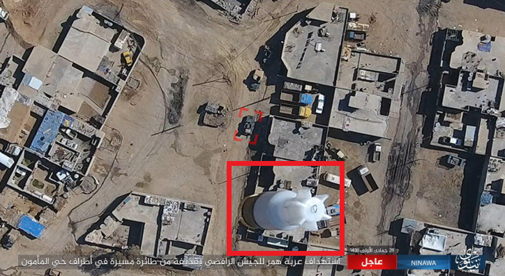 Bomb (in red) dropped from an ISIS armed drone on an Iraqi army vehicle in the west Mosul neighborhood of Al-Maamoun (the photo was released by ISIS's Nineveh Province on a file-sharing website, February 25, 2017)