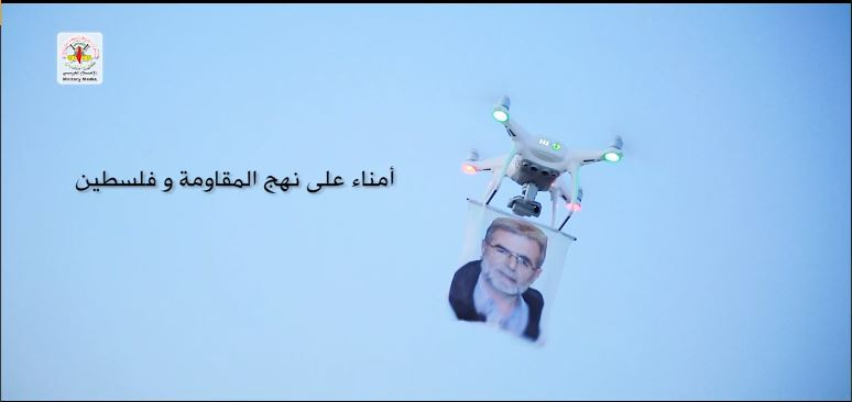 """A picture of al-Nakhalah in the video produced for the anniversary of the death of Fathi Shqaqi. The Arabic reads, """"Faithful to the path of resistance and Palestine."""""""