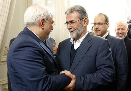 Ziyad al-Nakhalah shakes hands with Iranian foreign minister Mohammad Jawad Zarif during the visit of a PIJ delegation to Iran headed by Ramadan Shalah (Tasnim Agency, February 6, 2014).
