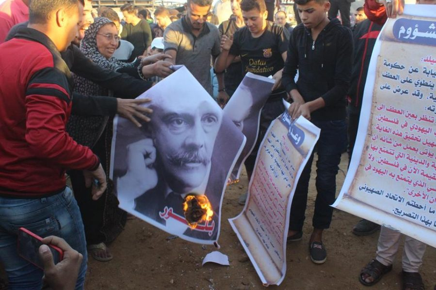 Palestinians burn copies of the Balfour Declaration and pictures of Lord Balfour in the