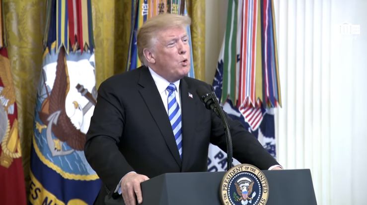 The US president announcing the approval of extensive sanctions against Hezbollah, during a White House ceremony in memory of Marines killed in a Hezbollah suicide bombing attack in Beirut (White House YouTube channel, October 25, 2018)