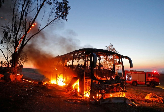 The bus in flames after having been hit by a Kornet anti-tank missile fired from the Gaza Strip (Twitter account of Hamas' military wing, November 12, 2018).