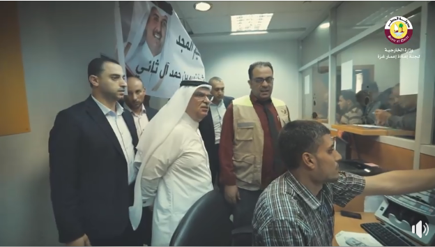 Mohammed al-Emadi, chairman of the Qatari Committee, supervises the disbursement of funds at post office branches in the Gaza Strip (Facebook page of the Qatari Committee, November 9, 2018).
