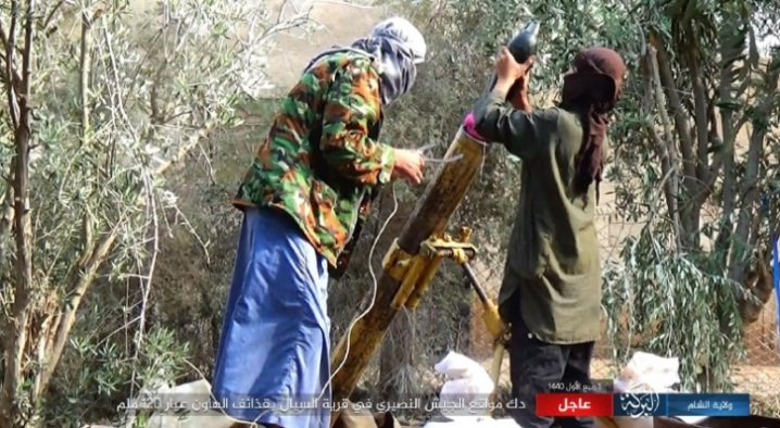 ISIS operatives firing a 120mm mortar shell at Syrian army positions on the west bank of the Euphrates, north of Albukamal (ISIS's Al-Barakah Province, November 9, 2018).