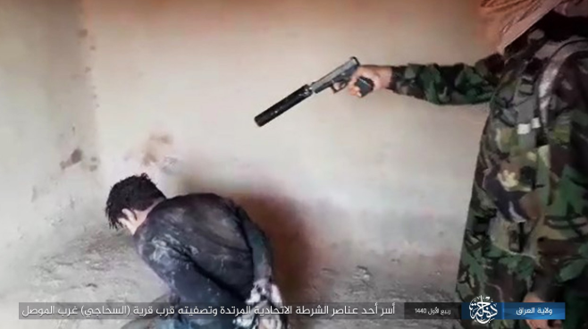 The execution of the member of the Federal Police ISIS's Iraq – Dijla Province, Iraq, November 11, 2018)