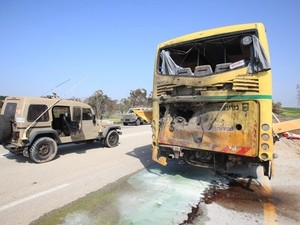 The school bus hit by the Kornet missile fired by Hamas  (Reuters, photo: Shalom Gaziel, April 7, 2011)