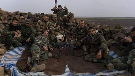 Syrian army soldiers after taking over a dominant hill in the Al-Safa area (Twitter, November 17, 2018).