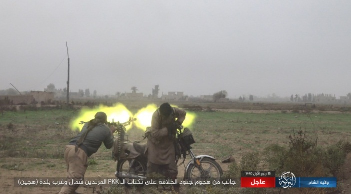 ISIS operatives firing a machine gun mounted on a motorcycle (Shumukh, November 24, 2018)