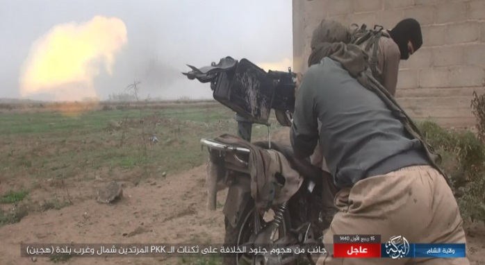 ISIS operative firing at SDF positions near the village of Al-Bahra (Shumukh, November 24, 2018).