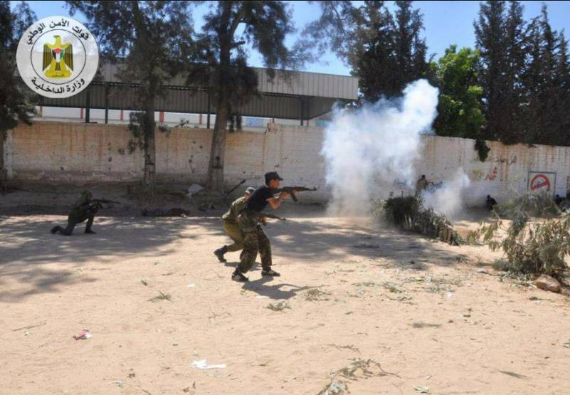 Al-Futuwwa students practice with live ammunition in a simulation of storming and taking control of an IDF post (al-Futuwwa Facebook page. March 26, 2013).