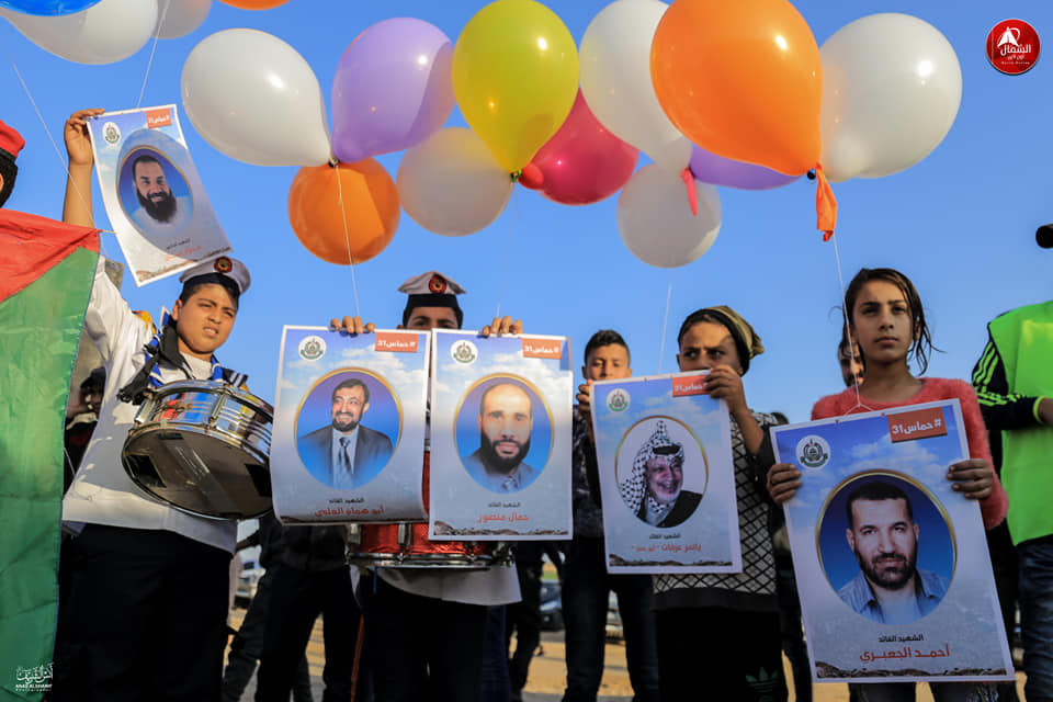 Launching balloons with pictures of Palestinians killed in the