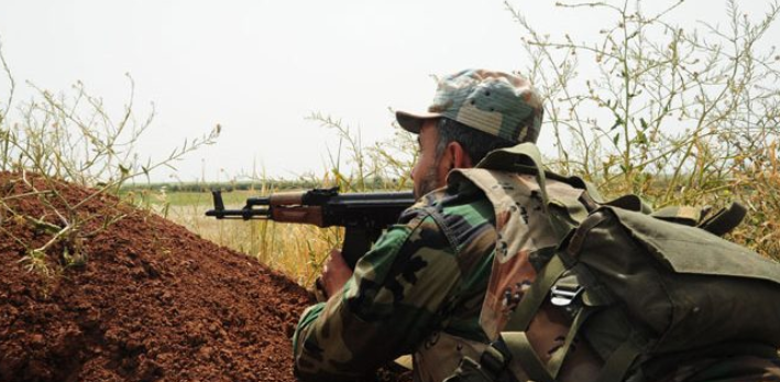 Syrian army soldier at a firing position in the rural area north of Hama (SANA, December 1, 2018)