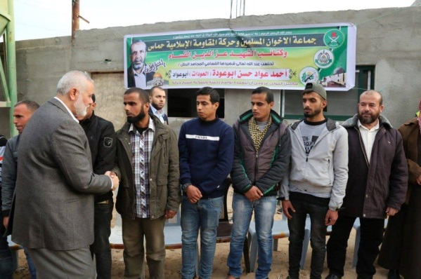 Isma'il Haniyeh pays a condolence call to the mourning tent erected for the Palestinian who died from smoke inhalation. The banner says that the Muslim Brotherhood movement, Hamas and its military wing announce the death of military wing operative Ahmed 'Awad Hassan Abu 'Awda (al-'Aweidat) (Palestine Live Facebook page, December 8, 2018).