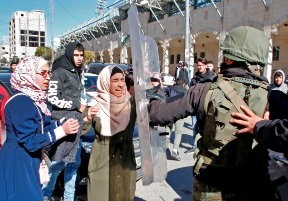 Suppressing the Hamas parades in Hebron.