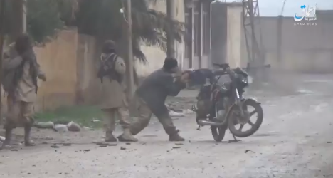 ISIS operative firing a heavy machine gun mounted on a motorcycle (Amaq, December 17, 2018)