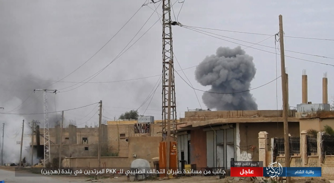 Smoke rising after a Coalition airstrike in the city of Hajin.