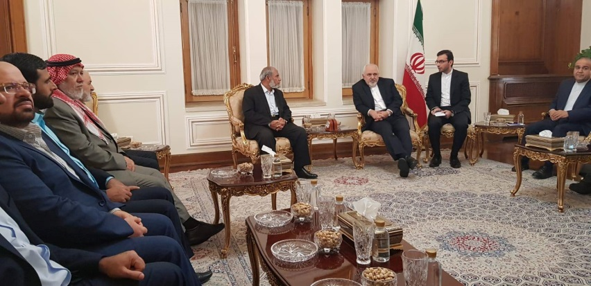 The Palestinian delegation meets with Iranian foreign minister Zarif (third from right) (Hamas Change and Reform faction Facebook page, December 23, 2018).