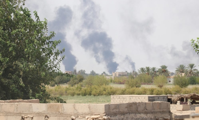 Smoke clouds after Coalition airstrikes in the city of Hajin (SDF Press, December 20, 2018).