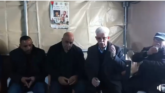 Senior Fatah figure Jamal al-Muheisen (third from left) in the solidarity tent erected by the family of Islam Yusuf Abu Hamid in the al-Am'ari refugee camp in Ramallah. He brought an official message from Mahmoud Abbas, saying the family's house would be fully rebuilt (Jamal al-Muheisen's Facebook page, December 15, 2018)