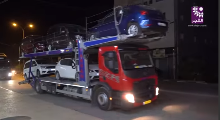 Al-'Awad receives new cars from the Port of Ashdod in Israel (al-Fajr TV, Tulkarm, October 31, 2018).