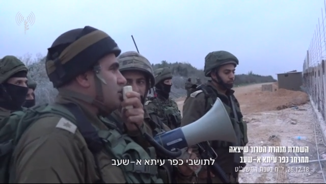 IDF soldiers call on the residents of the Shi'ite village of Ayta al-Shab to evacuate the area before the Hezbollah attack tunnel is blown up.