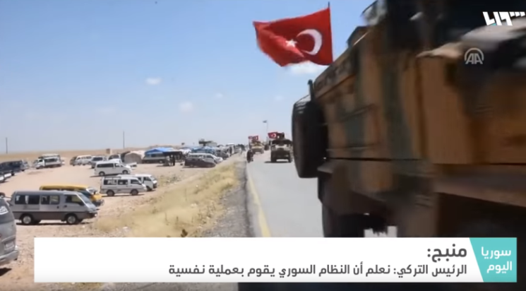 Turkish forces carrying the Turkish flag across the Syrian border, not far from Manbij (Syria TV, December 28, 2018)