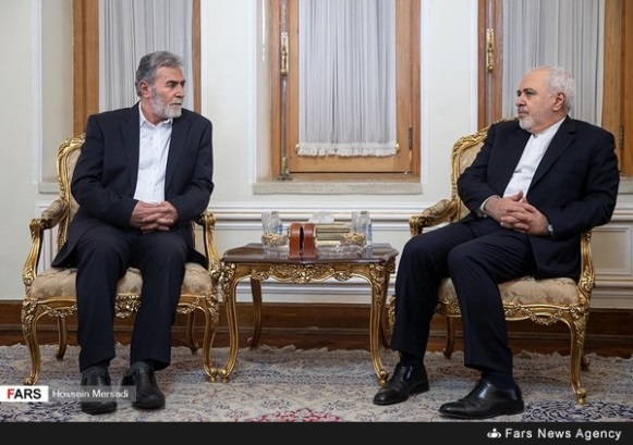 Mohammad Zarif (right) meets with the PIJ delegation (Fars News Agency in Arabic, December 30, 2018).
