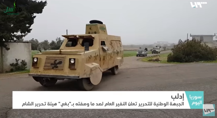 "Forces of the ""National Liberation Front"" (affiliated with Turkey) on their way to halt an attack of the Headquarters for the Liberation of Al-Sham against positions of the Nur al-Din Zenki Movement (Syria TV, January 2, 2019)"