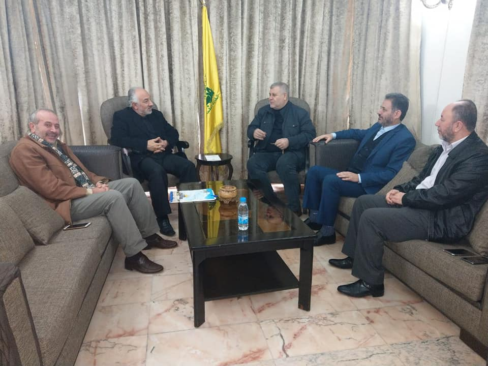 Khaled al-Batash (center) meets in Beirut with Hassan Huballah, in charge of Hezbollah's relations with the Palestinians (Facebook page of Ihsan Atiya, PIJ representative in Lebanon, January 9, 2019).