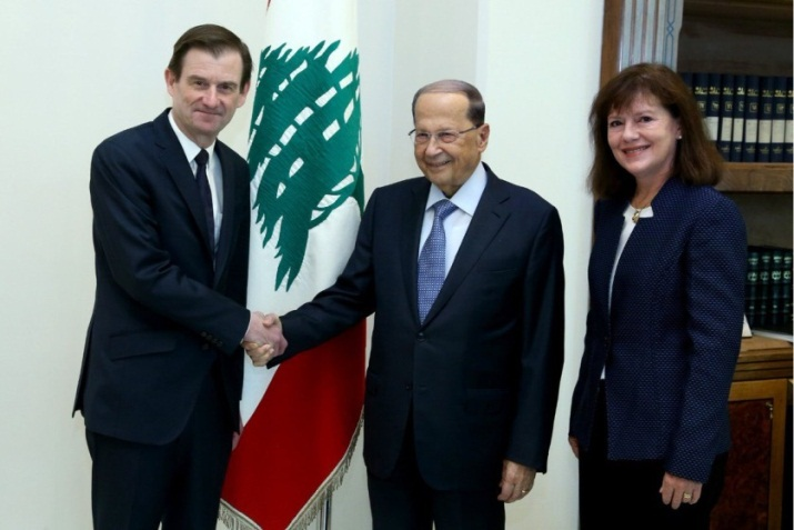 David Hill (left) shakes hands with Lebanese President Michel Aoun.