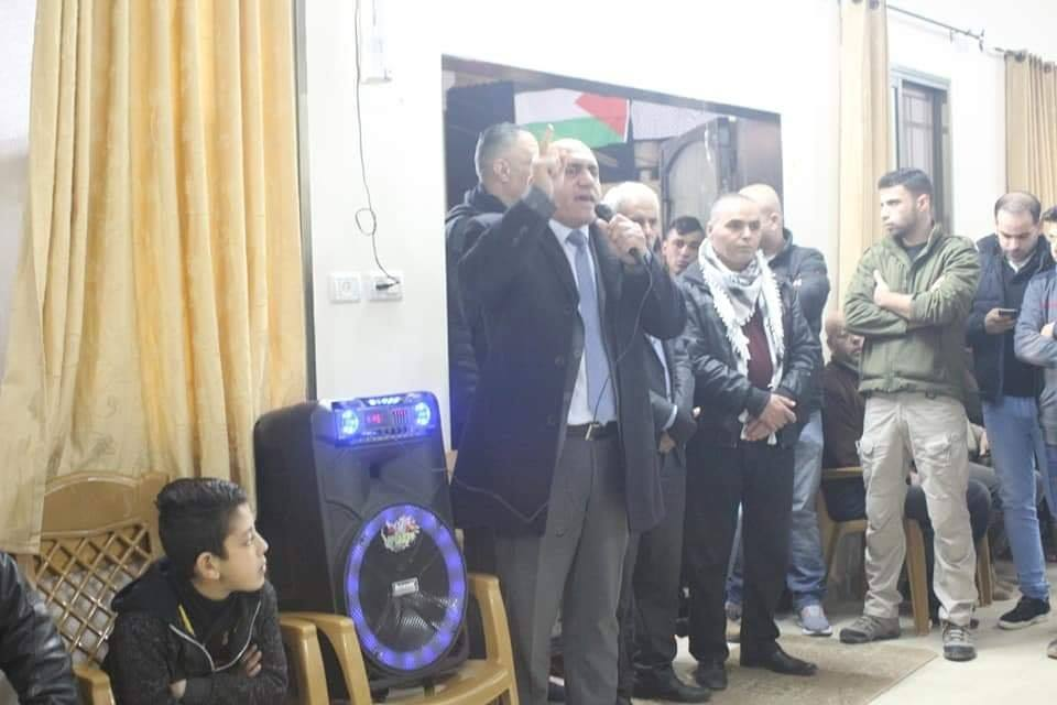 Jenin district governor Akram Rajoub (black coat, gray tie) at the event held at the home of the Jarar clan (Facebook page of Musab Zyoud, journalist from Jenin, January 21, 2019).