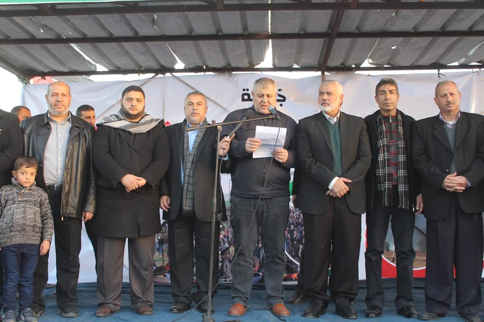 Isma'il Haniyeh (third from right) and Khalil al-Haya (extreme left) at the