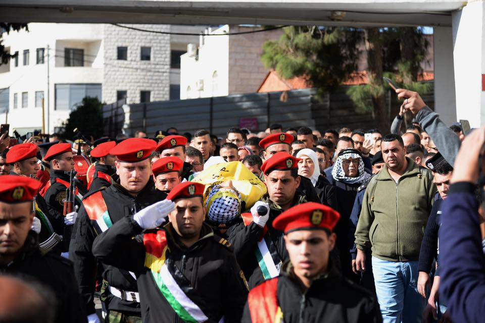 The military funeral held for Ayman Hamed. His body was wrapped in the Fatah flag (Facebook page of Ramallah district governor Laila Ghanem, January 26, 2019).