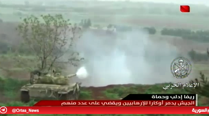 Syrian army tank attacking a target of the rebel organizations in the southern rural area of Idlib (Syrian TV, February 4, 2019)