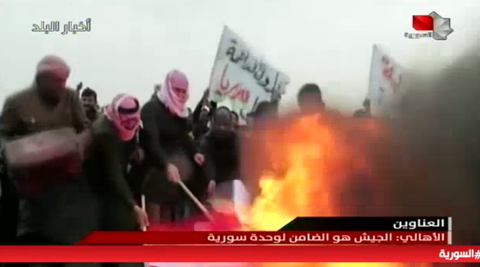 Syrian demonstrators burning American and French flags in Al-Raqqah (Syrian TV, February 9, 2019).